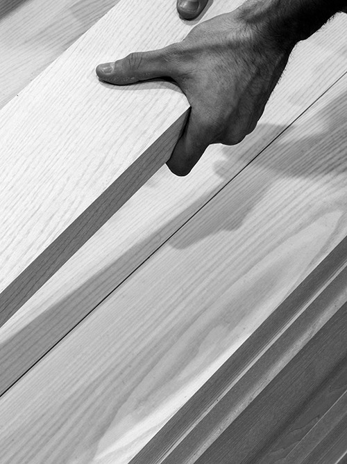 Hands holding some timber